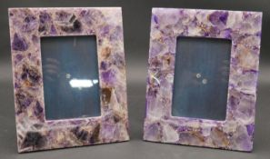 A pair of contemporary amethyst in resin easel photo frames. H.25.5 W.20.5cm