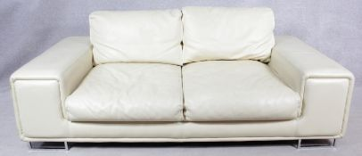A contemporary two seater sofa in ivory leather upholstery on chrome supports. H.80 W.204 D.104cm