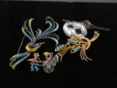 Collection of brooches, Including a silver, enamel and marcasite phoenix brooch, a plate of white