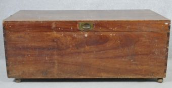 A 19th century camphor chest with inset military style brass handle. H.51 W.123 D.59cm