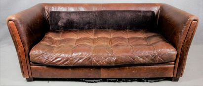 A tan leather tub sofa with buttoned cushion. Lacking its back cushion. H.78 W.19. D.95cm