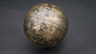 An Islamic celestial globe, engraved in brass with Islamic symbols and astrological diagrams. D.15cm
