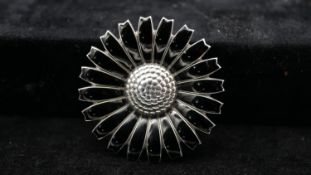 A large Georg Jensen sterling silver Danish daisy pattern brooch/pendant on silver round link