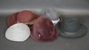 A collection of five ladies hats with designer labels including Gabriela Ligenza, Philip Treacy etc,