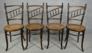 A set of four late 19th century Continental beech framed bentwood cafe style dining chairs with rail