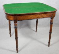 A 19th century mahogany fold over top card table on turned tapering supports. H.73 W.91 D.45cm