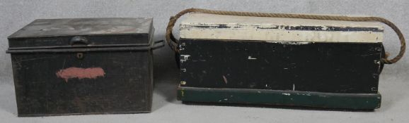 A painted pine travelling trunk with rope handles along with a metal example. H.31 W.78 D.27cm (