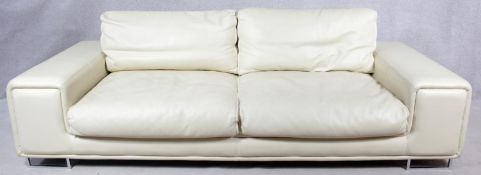 A contemporary two seater sofa in ivory leather upholstery on chrome supports. H.80 W.240 D.104