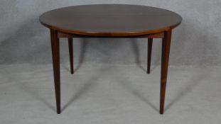 An extending dining table by Brande Mobelindustri, Denmark. H.71 L.220 W.120cm (fully extended, it