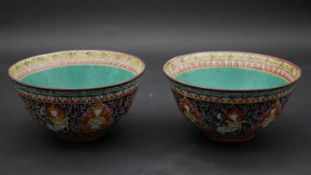 A pair of 19th century Bencharong Chinese antique enamel glazed bowls. The flared body painted in