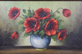 An oil on board, poppies in a vase, signed de Groot, in an ornate gilt frame. H.50 W.70cm