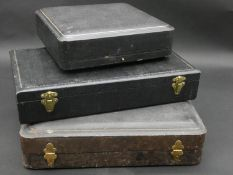 Three antique leather effect silver cruet boxes two with blue velour linings and one with an emerald