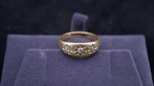A 18 carat yellow gold Victorian gypsy ring. Set with three oval old mine diamonds. The centre stone