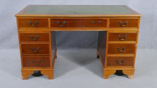 A Georgian style pedestal desk with inset leather top on bracket feet. H.79 W.137 D.69cm (missing