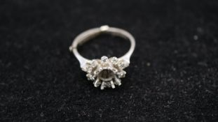 A 18 carat white gold and palladium vintage cluster ring shank set with ten round brilliant cut