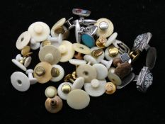 A collection of cufflinks and shirt studs. To include a pair of hallmarked silver and millefiori