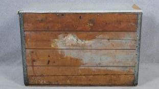 A vintage metal bound travelling trunk with twin carrying handles. H.73 W.92 D.46cm