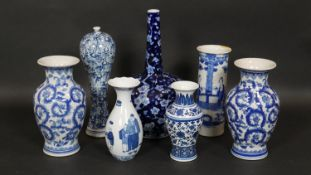 A pair of Chinese blue and white vases along with five other similar single vases. H.37.5cm