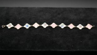 A Danish silver and guilloche enamel link bracelet. Alternating links in pink and white with various