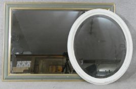 Two contemporary bevelled glass wall mirrors. H.104 W.74cm