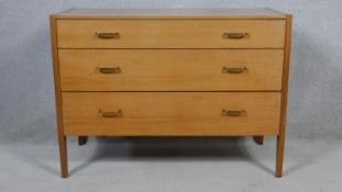 A mid century teak Heal's chest of drawers with Heal's exclusive design label. H.72 W.99 D.45cm