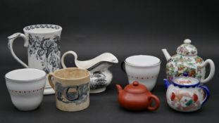 Three Oriental style teapots along with various ceramic items (8). H.14.5cm