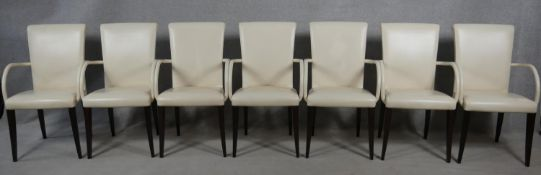 A set of seven contemporary Poltrona Frau Vittoria model dining armchairs in leather upholstery on