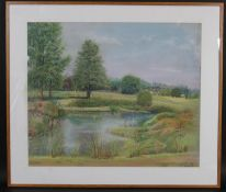 A framed and glazed pastel, pond in a landscape, indistinctly signed and dated. H.61 W.71cm