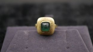 A 14 carat yellow gold and tourmaline dress ring. Set with a sugar loaf tourmaline with an