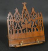 A Victorian mahogany adjustable table book or manuscript stand with Gothic pierced decoration. H.