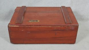 A C.1900 travelling bookcase/cabinet with twin metal carrying handles. H.31 L.85.5 W.54.5cm