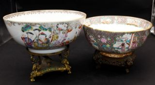Two antique Chinese Famille Rose bowls on stands, one stand French gilded brass and one Chinese
