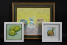 A pair of framed oils on board, still life lemons and an onion, monogrammed AM and dated and an