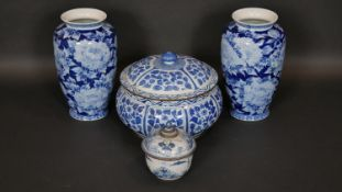 A pair of Chinese style baluster vases, a Chinese blue and white lidded tureen and a similar