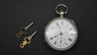 A Victorian silver pocket watch, the Accurate English Lever. With white enamel dial and black