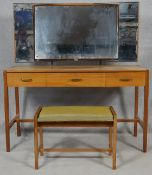 A mid century vintage teak Heal's dressing table and matching dressing stool with Heal's exclusive