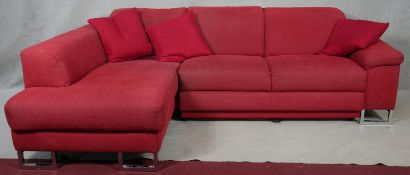 A contemporary ROM corner sofa with adjustable back cushions, converting to a double bed, on chrome