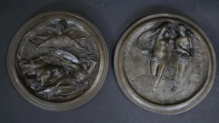A pair of bronze effect plaster relief plaques, marked Art Union of London. D.20cm