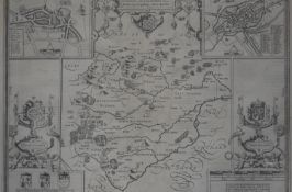 A framed and glazed antique engraved map of Rutlandshire with illustrated details and coats of arms.