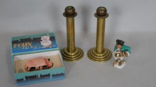 A pair of vintage brass candlesticks on stepped bases, a vintage boxed clockwork toy and a ceramic