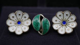 A pair of Danish silver David Andersen white and blue enamel flower clip earrings along with an