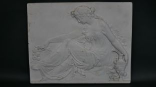 A antique faux marble relief plaque with bronze medal in the back which reads 'Exposition