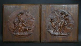 A pair of copper relief panels depicting scenes from Classical Antiquity applied to mahogany panels.