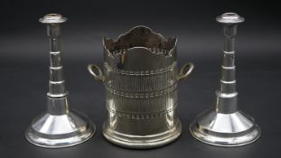 A pair of silver candlesticks of circular stepped design marked Israel 833 and a C.1900 silver