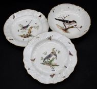 A pair of Meissen style 19th century plates and a matching bowl each hand decorated with birds and