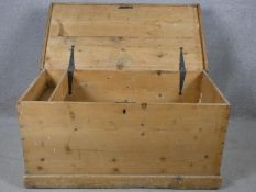 A 19th century pine storage trunk fitted with candle box on plinth base. H.46 W.93 D.48cm