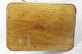 A 19th century mahogany tilt top lamp table on tripod cabriole pedestal base. H.73 W.46 D.44cm