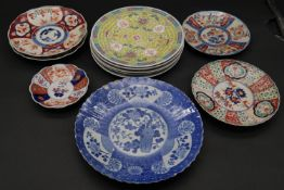 A set of four Chinese plates, a blue and white plate, a pair of Imari side plates and three other