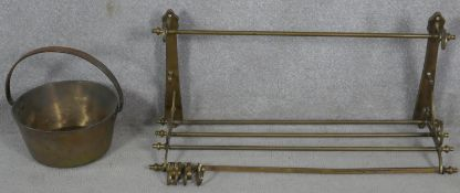 A 19th century brass wall mounted kitchen utilities rack and a heavy brass Victorian swing handled