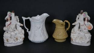 A Portmeirion Parian water jug with relief decoration, a 19th century Ridgeway jug and a pair of